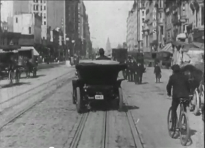 Pedestrians, cyclists, and buggies learn to cope ... somehow, circa 1906