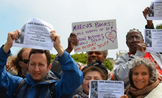 People pray for Marcus Books at the church of the new owner of the building - STEVE RHODES