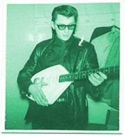 Pete Miller and his Vox Phantom guitar backstage in 1964.