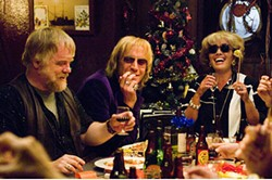 Philip Seymour Hoffman, Rhys Ifans, and Emma Thompson indulge in some tame debauchery.