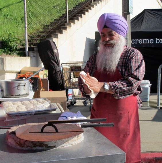Piping hot nan, straight from the tandoor! - LOU BUSTAMANTE