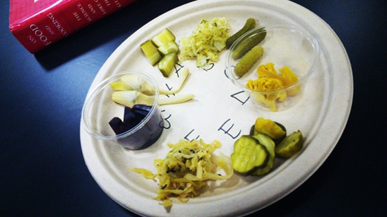 Plates of pickles for a blind tasting exercise - WENDY HECTOR
