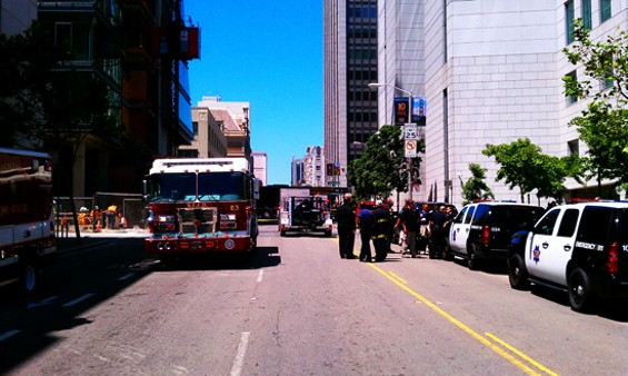 Police and firefighters respond to the bomb threat at Civic Center. - JOE ESKENAZI