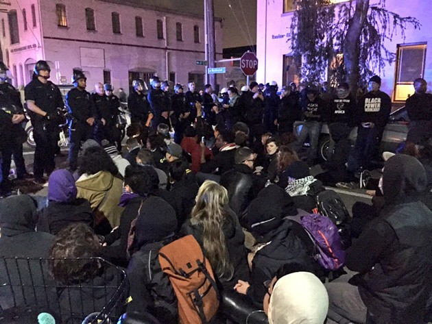 Protesters held an impromptu sit-in Saturday night - JULIA CARRIE WONG