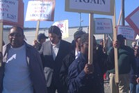 Protesters outside the UCSF VIP groundbreaking on Tuesday
