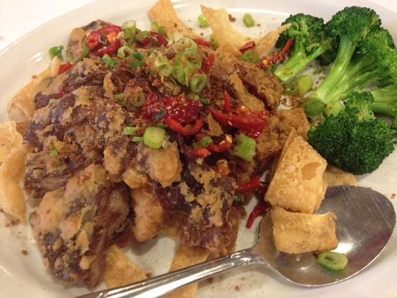 Quan Ju Fu's salt-and-pepper fried duck. - TAMARA PALMER