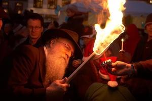 Rabbi Yosef Langer has been doing this for 36 years. No horrific burns yet.
