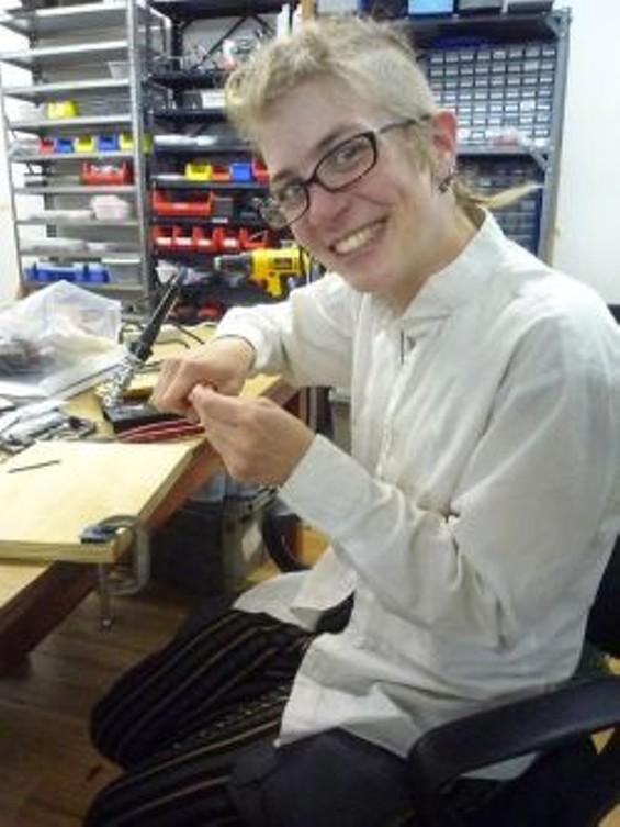 Rachel Lyra Hospodar fixes a (mildly) busted circuitboard.