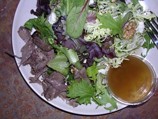 Radius' duck confit salad with blue cheese and walnuts. - J. BIRDSALL