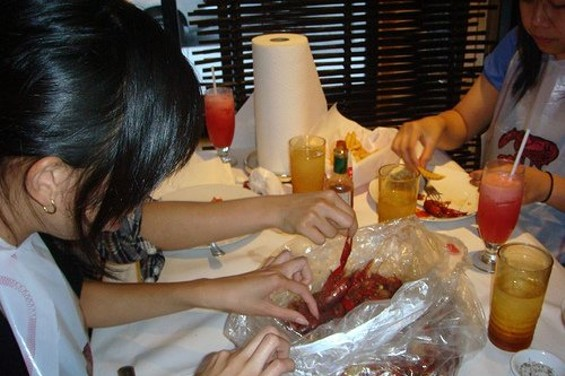 Raiding the bag at Red Crawfish. - LINDA C./YELP