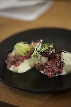 JULIA SPIESS - Raw beef and mustard greens.