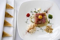 JEN SISKA - Raw times two: Ahi tuna tartare with uncooked quail egg.