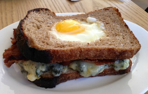 Reveille's breakfast sandwich is a take on toad-in-the-hole. - JOSH LESKAR