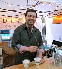 Reza Esmaili mixes up a few milk juleps. - LOU BUSTAMANTE