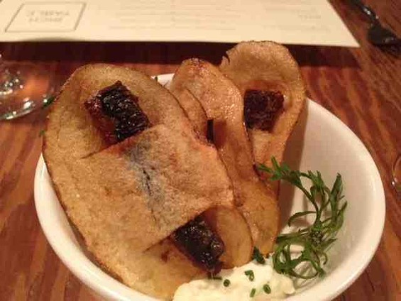 Rich Table's sardine chips with whipped horseradish creme fraiche and pepper cress. - TAMARA PALMER