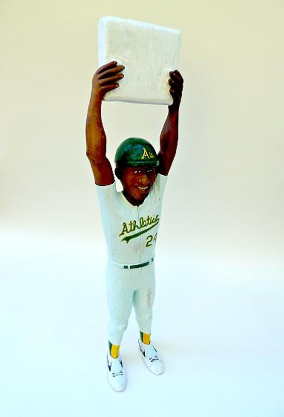 Rickey's Big Day depicts Oakland Athletic Rickey Henderson holding up second base the day in 1991 that he broke the record set by Lou Brock. Henderson's record still stands and probably will for a long time. - CHRIS DONNELLY