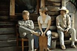 Robert Redford and Morgan Freeman are - Wyoming cowboys who shelter widowed - mom Jennifer Lopez in An Unfinished - Life.