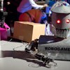 """Robots Invade a Bar to Serve Drinks and Raise Money for Their """"Olympics"""""""