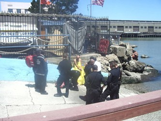 Ronald Morgan, in yellow tarp, was arrested Saturday after allegedly attempting to steal a boat while in the nude - DEANNA DESIN