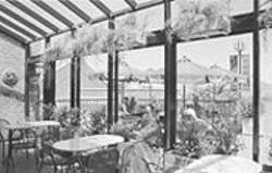 ANTHONY  PIDGEON - Room With a View: The protected terrace at Frjtz, where you can sit, schmooze, and contemplate the bay.