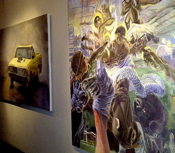 Sacred things: One of Scott Inguito's El Camino paintings (left) seems at home alongside a Kellen Breen depiction of Jesus.