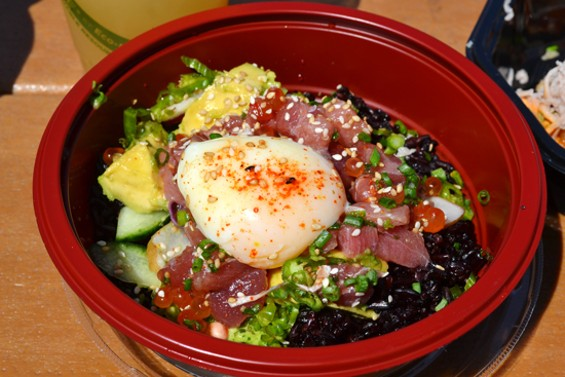 Sammy's Aloha ahi poke bowl with Thai black sticky rice, topped with a poached egg, salmon roe and garden fresh fixings. - ANASTASIA CROSSON