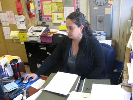 Sandra Rios, secretary at Longfellow Elementary School, is about to lose her job because of puzzling union seniority rules.