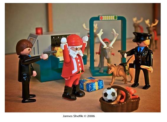 Santa enjoys the relaxing airport travel home for Christmas. - JAMES SHEFIK