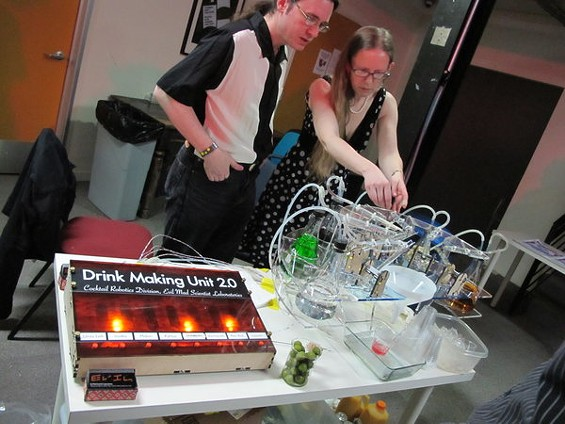 Science geeks tinkering with wires wasn't exactly what we expected from a night devoted to robot bartenders. - ANDY GUSTIN