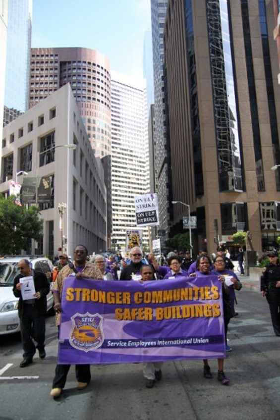 Security workers march through downtown SF on Wednesday, June 5. - JOSEPH GEHA