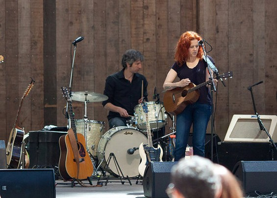 See how you can see Neko Case's new tattoos, but you also can't see them? - FLICKR/BIGOTEETOE