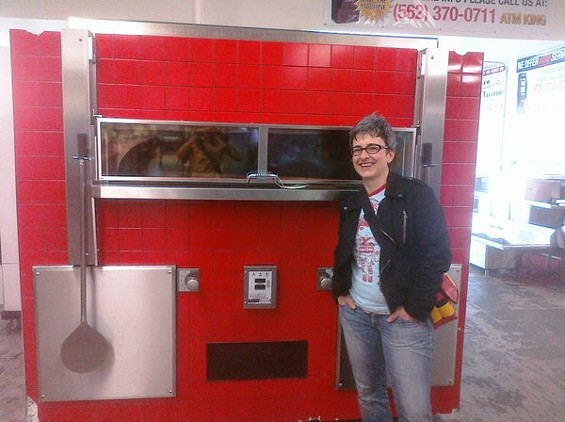 Sharon Ardiana, with the highly red pizza oven for soon-to-open Ragazza on Divis.