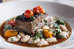 NATHANIEL DOWNES - Short ribs, butter beans, and cherry tomatoes work in harmony.