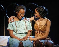 PAUL KOLNIK - Showgal Shug Avery (Michelle Williams, right) gives Celie (Jeannette Bayardelle) some love.