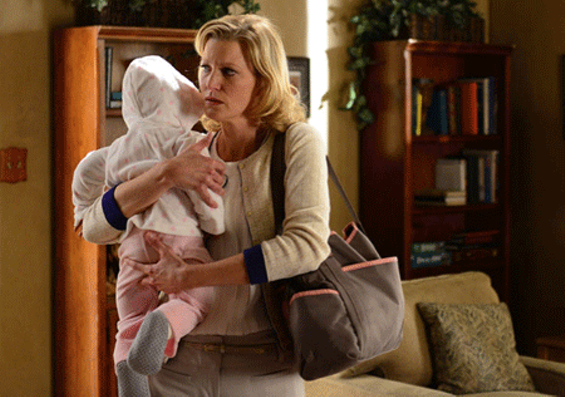 Skyler earmarks some of Walt's $11 million for Holly's future therapy. - PHOTO COURTESY OF AMC.