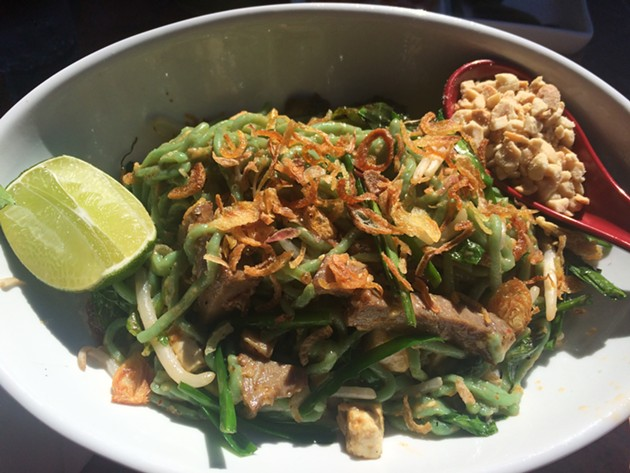 Emerald fire noodles (spinach wheat noodles, tofu, sprouts, herbs and curry sauce). - PETE KANE