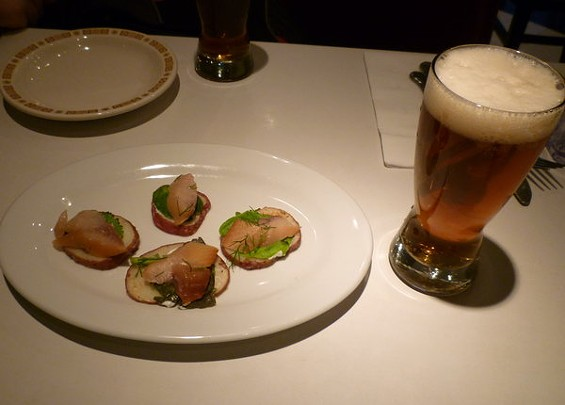 Smoked herring on potato coins, paired with Shmaltz's Genesis Ale. - ALEX HOCHMAN