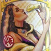 Snakebitten: Sideshow Performer Sues Local Brewer, Claims He Swiped Her Image to Hawk 'Coney Island Albino Python' Beer