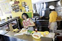 ANTHONY  PIDGEON - Snap and Sizzle: World Sausage Grill offers two - dozen varieties of its namesake.