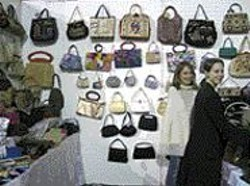 Some of the luxe handbags you'll see at the expo, plus - two of the shoppers you must battle to get to them.