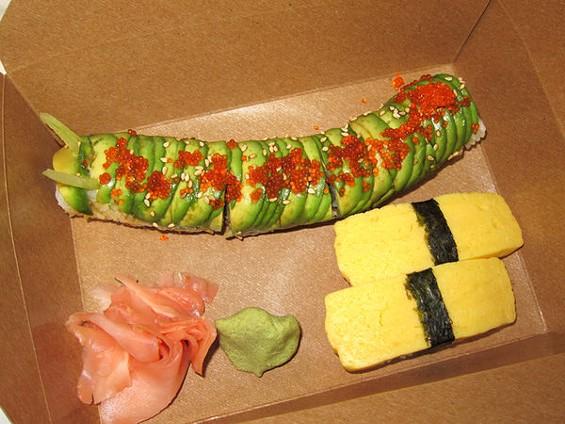 Somewhere Sushi's caterpillar roll, $9.95, and tamago nigiri, $2.75. - LUIS CHONG