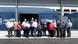 SSFSC managing partners and elected offcials from South San Franscisco, Millbrae, Brisbane and Colma join SSFSC President Doug Button in a ribbon cutting ceremony for the company's new dry anaerobic digester. - SSFSC