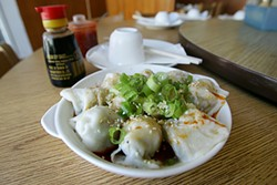 MIKE KOOZMIN - Spicy pork and chive dumplings are just one of many to order at Shanghai Dumpling King.