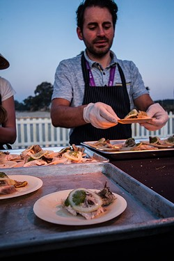 SPQR's Matthew Accarrino plates his sturgeon dish for Meatopia. - THE DAPPER DINER
