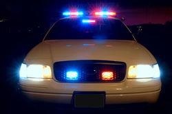 800px_police_car_with_emergency_lights_on_thumb_250x166_thumb_250x166.jpg