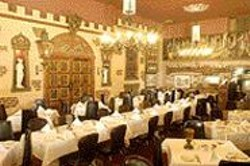 ANTHONY  PIDGEON - Stage Set: Gold Mirror's timeless - setting looks like the quintessential - Italian restaurant.