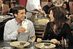 Steve Carell romances single mom - Catherine Keener in The 40-Year-Old - Virgin.