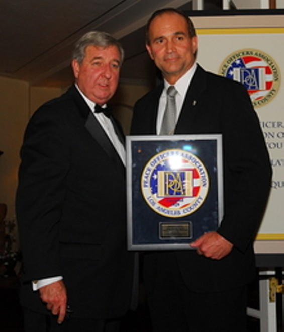 Steve Cooley, left, handed disgraced Bell Police Chief Randy Adams an award in 2008. Did he do so again by not prosecuting him? - PEACE OFFICERS ASSOCIATION OF L.A. COUNTY