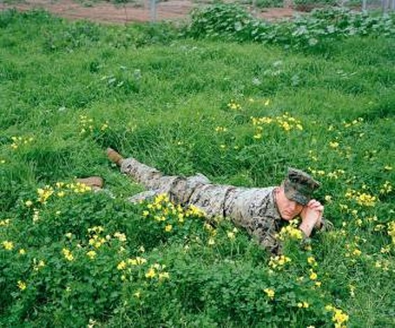 Steven in a Bed of Flowers, from the series He Opened Up Somewhere Along the Eastern Shore - COURTESY OF JASON HANASIK