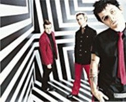 MARINA  CHAVEZ - Stripes and Rock Stars Forever: Green Day returns to - form with American Idiot.